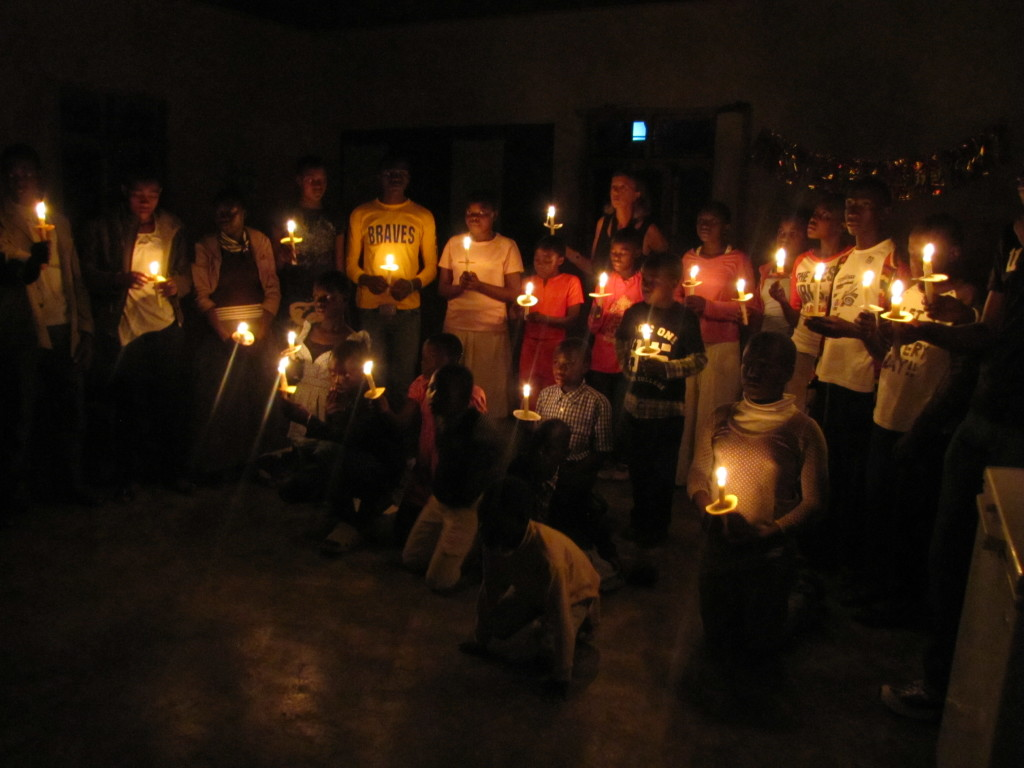 Singing Christmas songs by candlelight.