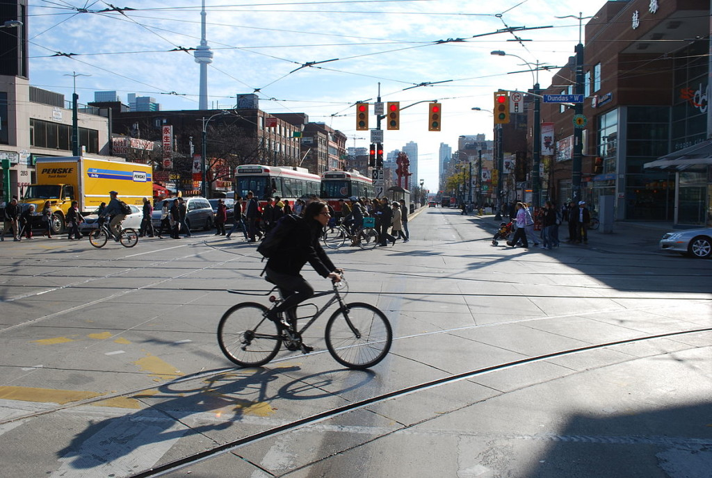 """Bicycling downtown Toronto"" by Hallgrimsson - Own work. Licensed under CC BY-SA 3.0 via Wikimedia Commons"