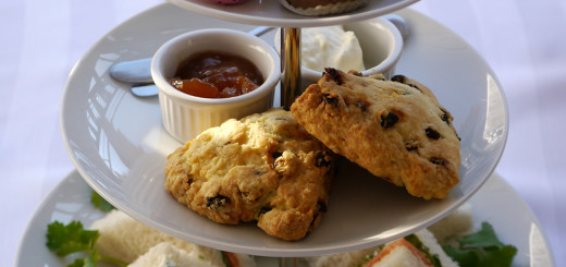 Triangle sandwiches, scones with clotted cream and jam and a selection of Dufflet desserts