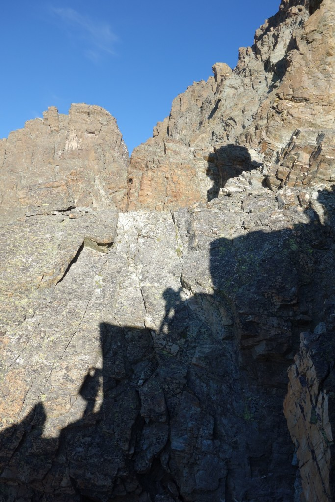 Our shadows reflect on the vertical rocks as we climb our way up